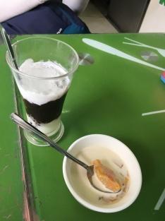 Dessert...yogurt with black sticky ice and mango with cream