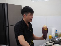 Our teacher....showing us how to use a banana flower